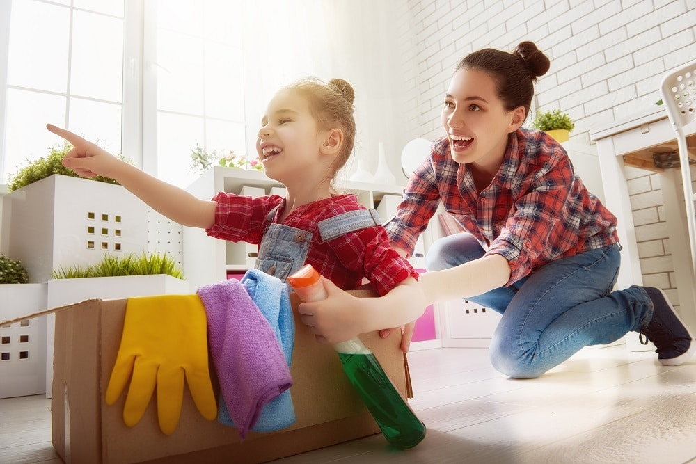 Happy family cleans the room. Mother and daughter do the cleanin